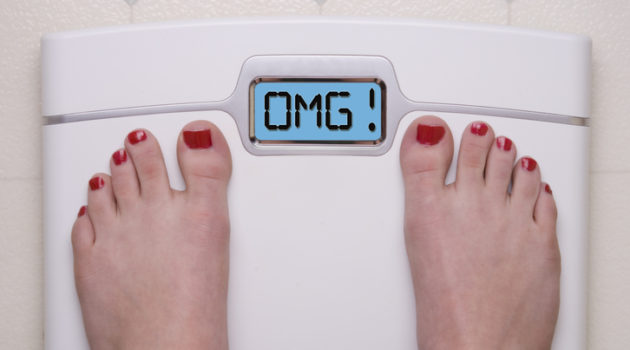 bathroom scale reads OMG