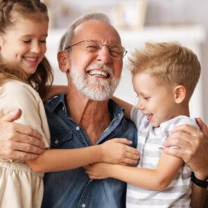 Image of man hugging children