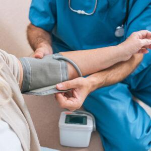 Image of nurse taking patient's blood pressure