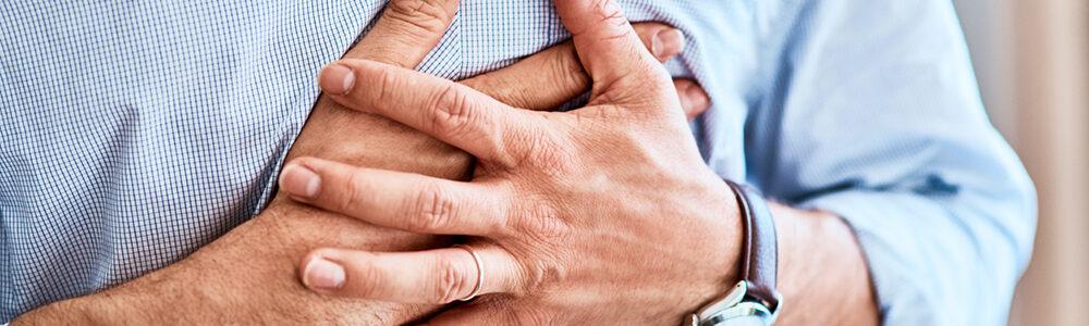Person grabbing their chest