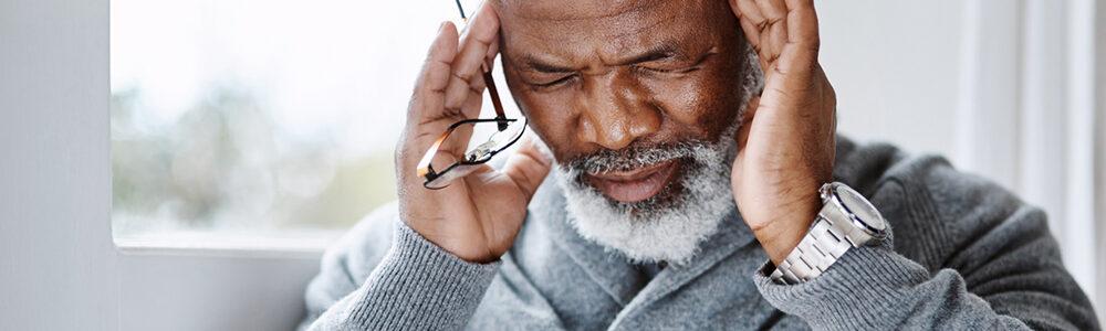 Image of man rubbing his head